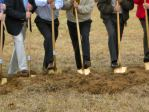 University-related people dug dirt Friday in anticipation of a new sports complex.